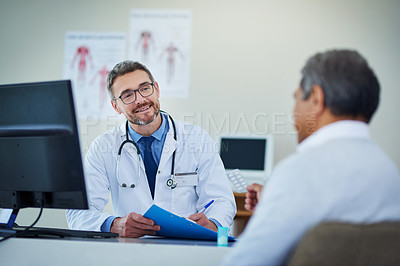 Buy stock photo Shot of a mature doctor having a consultation with a patient in his office