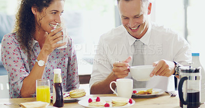 Buy stock photo Shot of a happy middle aged couple having breakfast together in the morning at home