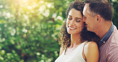 Buy stock photo Shot of a happy and affectionate mature couple spending quality time together outdoors