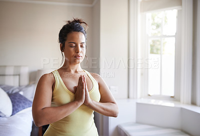 Buy stock photo Shot of a beautiful young woman practicing yoga at home