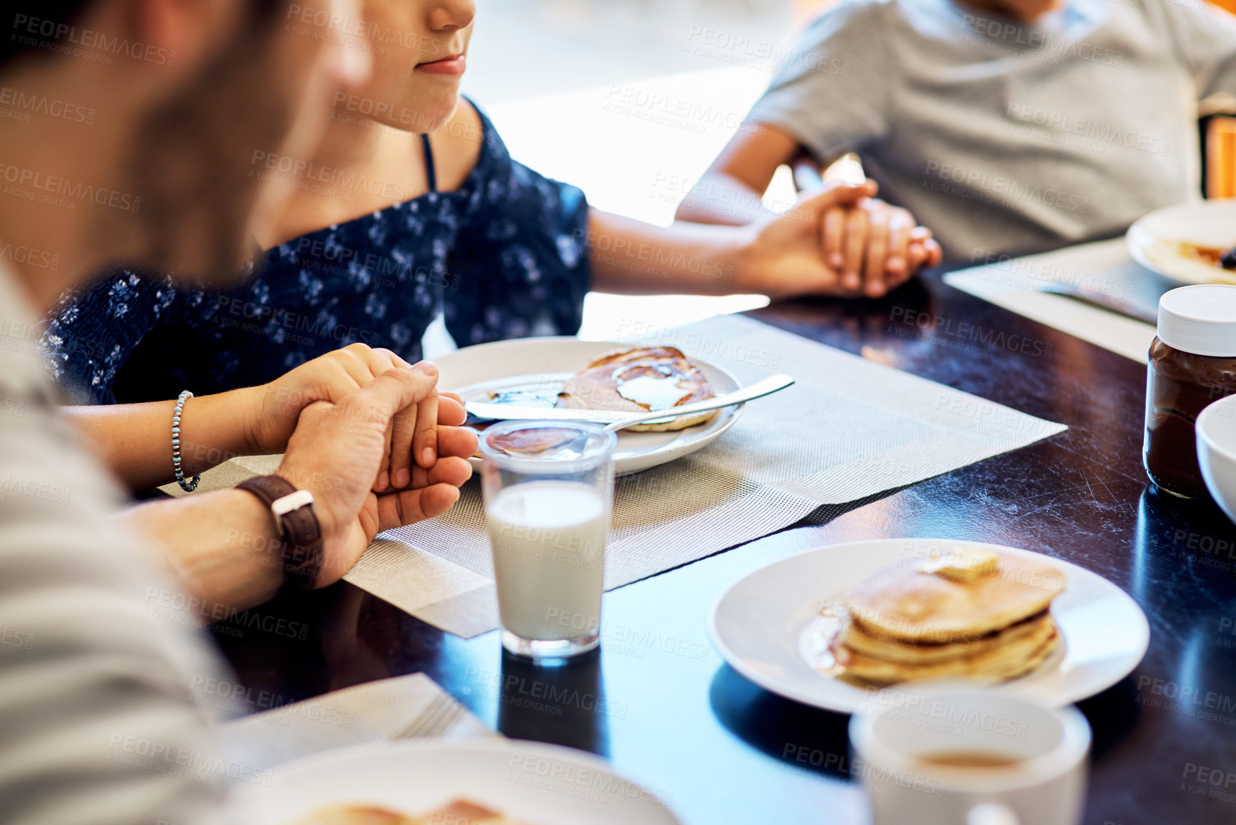 Buy stock photo Closeup shot of a family praying before enjoying their meal together at home