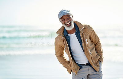 Buy stock photo Shot of a mature man enjoying a day at the beach