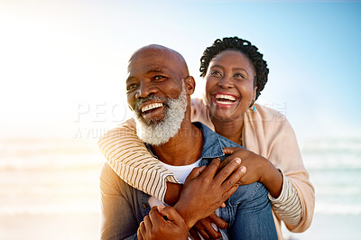 Buy stock photo Shot of a mature couple enjoying some quality time together at the beach