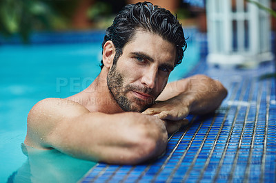 Buy stock photo Cropped shot of a handsome young man in the swimming pool at home