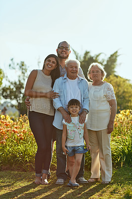 Buy stock photo Shot of a happy family of three generations spending quality time together in the park