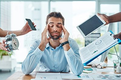 Buy stock photo Portrait of a young businessman looking stressed out in a demanding office environment
