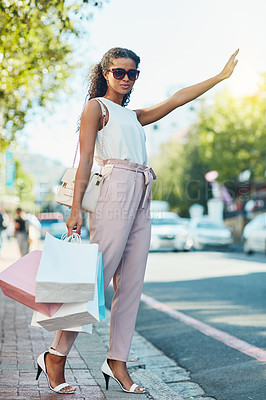 Buy stock photo Shot of an attractive young woman going shopping in the city