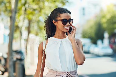 Buy stock photo Shot of an attractive young woman on a call out in the city