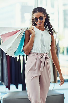 Buy stock photo Shot of an attractive young woman on a shopping spree in a boutique