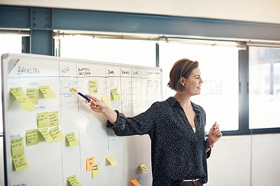 Buy stock photo Shot of a businesswoman giving a presentation in an office