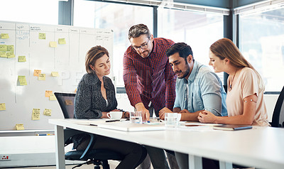 Buy stock photo Shot of a group of businesspeople having a meeting in an office