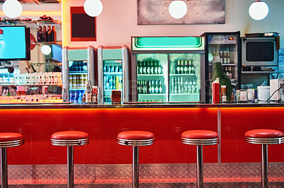 Buy stock photo Cropped shot of bar stools in a retro diner