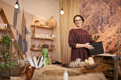 Buy stock photo Shot of an entrepreneurial young woman working in a store