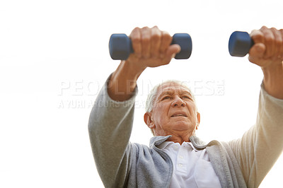 Buy stock photo Cropped shot of a senior man working out at home