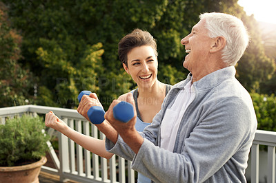 Buy stock photo Cropped shot of a senior man working out with a female instructor at home