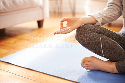 Buy stock photo Closeup shot of an unrecognizable woman practicing yoga in the living room at home