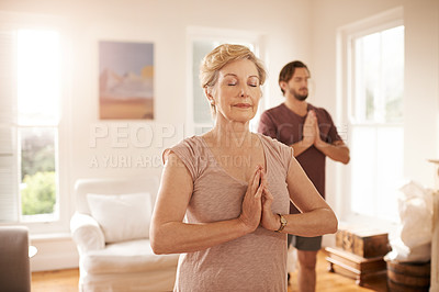 Buy stock photo Cropped shot of a senior woman practicing yoga with a male instructor at home