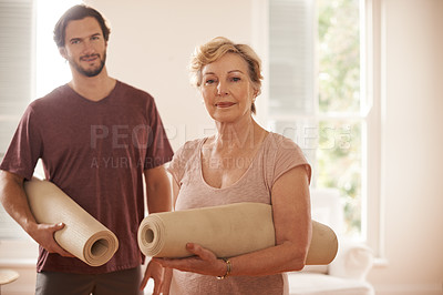 Buy stock photo Cropped shot of a senior woman getting ready to do yoga with a male instructor at home