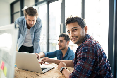 Buy stock photo Portrait of a young designer having a meeting with his colleagues in an office