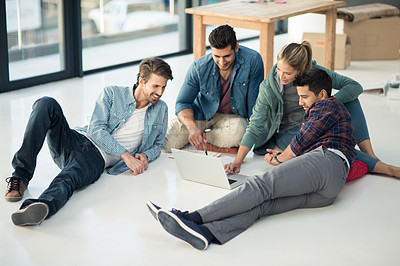 Buy stock photo Shot of a group of designers brainstorming on the floor in an office