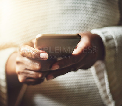 Buy stock photo Closeup shot of an unrecognizable woman using a cellphone at home