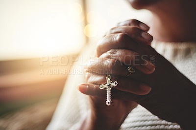 Buy stock photo Closeup shot of an unrecognizable woman holding a rosary while praying