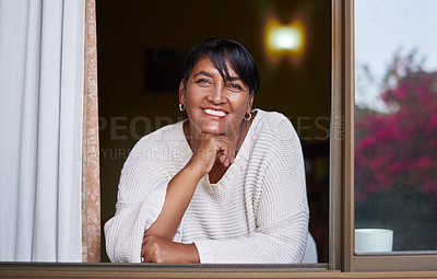 Buy stock photo Portrait of a mature woman relaxing at home