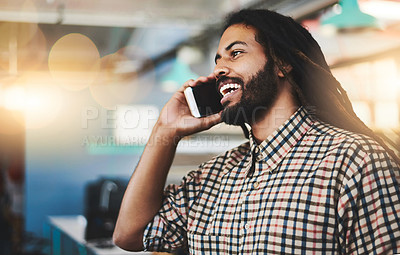 Buy stock photo Cropped shot of a handsome young male designer making a phonecall while standing in his office
