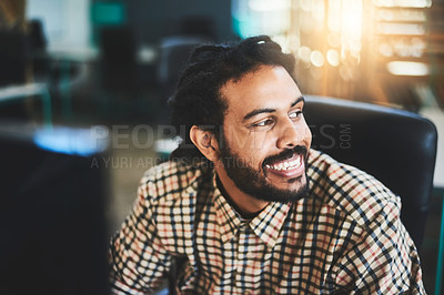 Buy stock photo Cropped shot of a handsome young male designer working in his office
