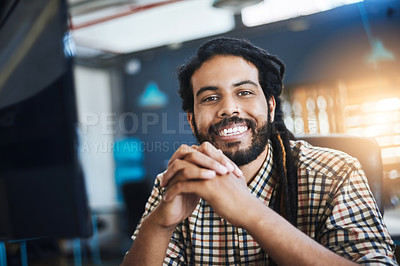Buy stock photo Cropped portrait of a handsome young male designer working in his office
