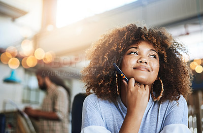 Buy stock photo Cropped shot of an attractive young female designer looking thoughtful while sitting in her office