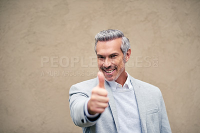 Buy stock photo Cropped shot of a smartly dressed mature businessman showing thumbs up outside