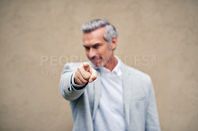 Buy stock photo Cropped shot of a smartly dressed mature businessman pointing outside