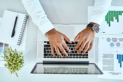Buy stock photo High angle shot of an unrecognizable businessman working on a laptop in an office