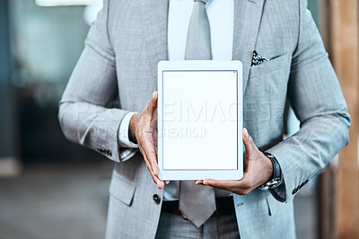 Buy stock photo Closeup shot of an unrecognizable businessman holding up a digital tablet with a blank screen in an office