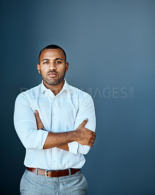 Buy stock photo Studio portrait of a young businessman standing against a grey background