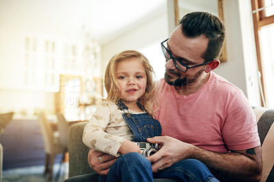 Buy stock photo Shot of a father and his little girl playing with a camera together at home