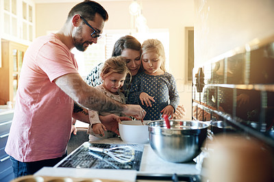 Buy stock photo Shot of a family baking together at home