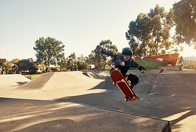 Buy stock photo Shot of a young girl skateboarding at a skatepark