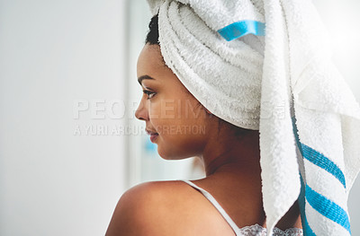 Buy stock photo Shot of an attractive young woman standing in the bathroom at home