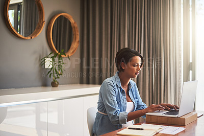 Buy stock photo Shot of a pregnant young woman using a laptop while working from home