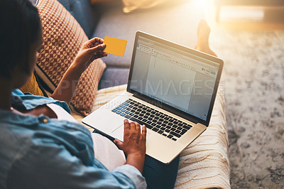 Buy stock photo Cropped shot of a pregnant woman using a laptop and credit card on the sofa at home