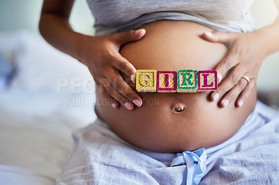 Buy stock photo Cropped shot of a pregnant woman with wooden blocks on her belly that spell the word girl