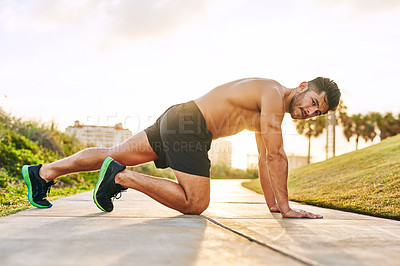 Buy stock photo Portrait of a handsome young man exercising outdoors