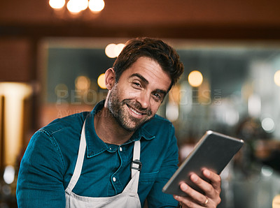 Buy stock photo Portrait of a cheerful young working man browsing on his cellphone inside of a beer brewery during the day