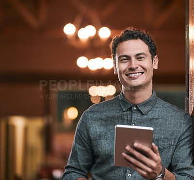 Buy stock photo Shot of a confident young man browsing on a digital tablet while standing inside of a beer brewery during the day