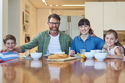 Buy stock photo Portrait of a happy family enjoying a meal together at home
