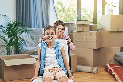 Buy stock photo Portrait of a happy young brother and sister on moving day