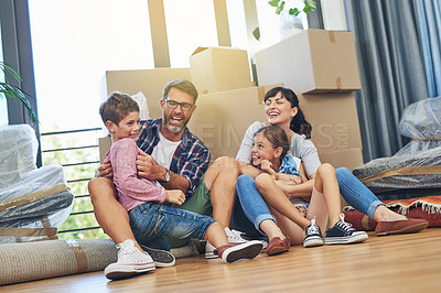 Buy stock photo Shot of a happy family spending time together in their home on moving day