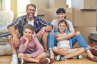 Buy stock photo Portrait of a happy family spending time together in their home on moving day